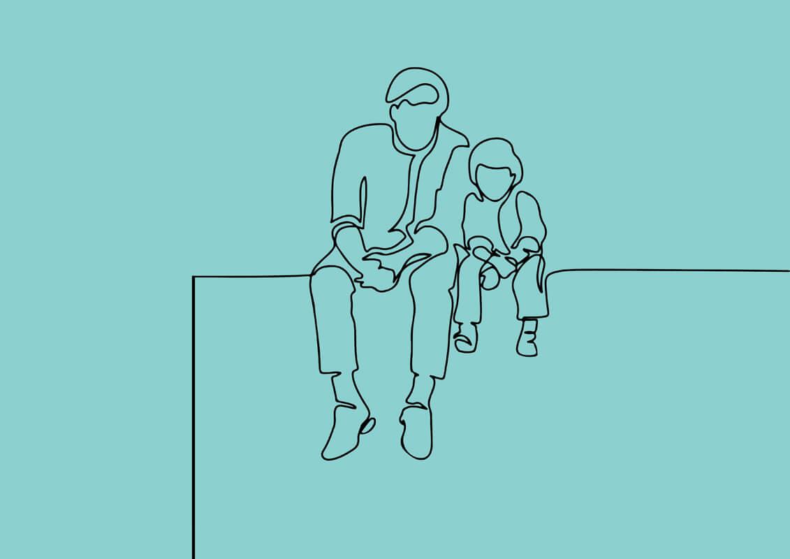 Un père et son fils sont assis sur un muret.
